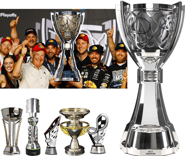 Racing team celebrating with the Monster Energy NASCAR Cup