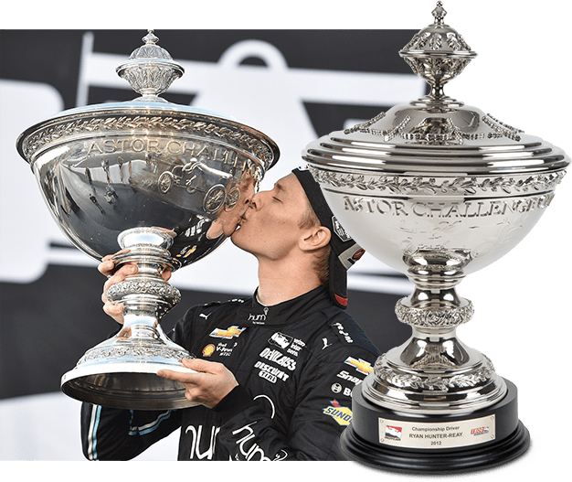 Josef Newgarden kissing the Astor Cup